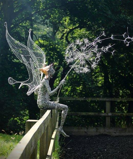 elf with dandelion sculpture
